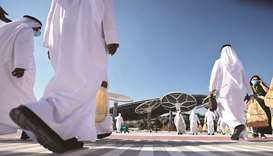 People walk towards the Sustainability Pavilion, a week ahead of its public opening, at the Dubai Ex