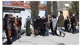 Relatives of the victims arrive at the site following gunmen shot dead two Afghan women judges worki