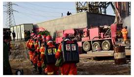 This photo taken on January 13 shows rescuers working at the site of gold mine explosion where 22 mi