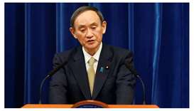 Japan's Prime Minister Yoshihide Suga speaks during a news conference at the PM's official residence