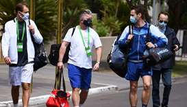 Polish tennis player Lukasz Kubot (L), trainer Hermanus Kroes (C) and Brazilian tennis player Marcel