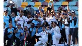 India's players and officials celebrate with the winning trophy at the end of the fourth cricket Tes