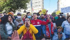 Tunisian protesters shout slogans during an anti-government demonstration in the capital Tunis, yest