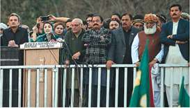 Maryam Nawaz addresses a PDM rally with other leaders in front of the election commission in Islamab