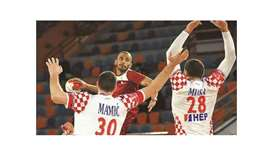 Qatar's Ahmad Madadi scores against Croatia during the 27th IHF Men's Handball World Championship –