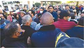 Tunisian protesters take part in an anti-government demonstration on the Habib Bourguiba avenue in t