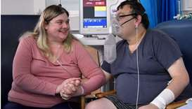 Elizabeth Kerr, 31, and Simon O'Brien, 36, embrace each other in a Covid-19 ward, days after they ma