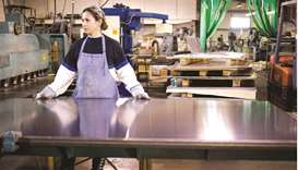 A woman works with a shear cutter at a welding and manufacturing company in Dallas. The FOMC has its