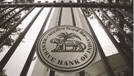 The Reserve Bank of India seal is pictured on a gate outside its headquarters in Mumbai (file). Indi