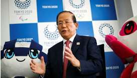 Toshiro Muto, Tokyo 2020 Organizing Committee Chief Executive Officer, speaks next to Tokyo 2020 Oly
