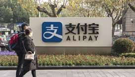 A pedestrian walks past an Alipay sign outside an Ant Group Co office building in Shanghai (file). O