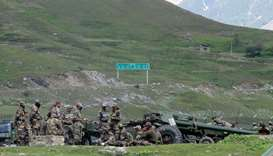 (file photo) Indian army soldiers rest next to artillery guns at a makeshift transit camp before hea