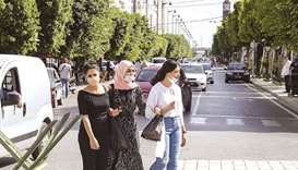 "Mask-clad women cross the Avenue Habib Bourguiba in the centre of Tunisia's capital Tunis (file). ""T"