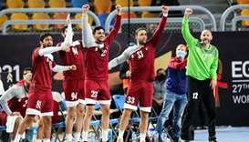 Qatar players celebrate after their win over Argentina during the 2021 World Handball Championship a