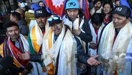 Nepali mountaineer Nirmal Purja (C) talks to the media along with his team at the Tribhuvan Internat
