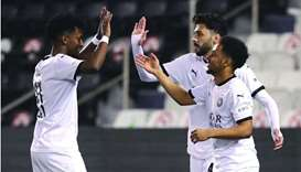 Al Sadd's Youssef Abdel Razaq (left) celebrates after scoring agianst Muaither in the last 16 match