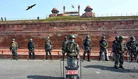 Police stand guard at Red Fort in New Delhi as police closed several main roads a day after farmers