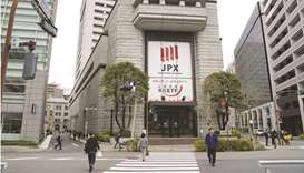 Pedestrians walk by the Tokyo Stock Exchange building, operated by Japan Exchange Group. The Nikkei