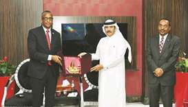 Qatar Chamber's second vice chairman Rashid bin Hamad al-Athba hands over a token of recognition to