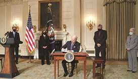 US President Joe Biden signs executive orders on tackling climate change as members of his climate t