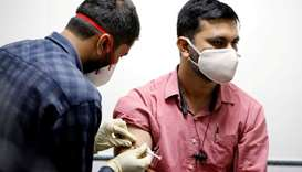 A medic administers COVAXIN, an Indian government-backed experimental Covid-19 vaccine, to a health