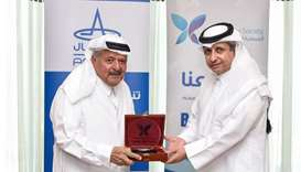 Qatar Cancer Society and Aamal sign agreement