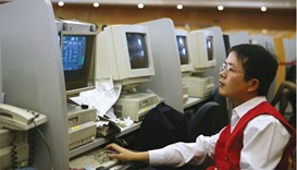 A trader works at the Shanghai Stock Exchange. The Shanghai Composite Index has rallied 13% in 2015,