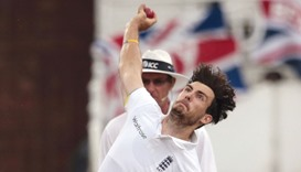 Steven Finn bowls during the fourth day of the first cricket Test against South Africa at the Kingsm