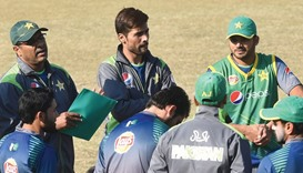 Pakistani coach Waqar Younis (left) speaks to players as Mohammad Amir (centre) and Azhar Ali listen