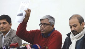 AAP leader Ashutosh shows the letter purportedly written by Jaitley, at a press conference in New De