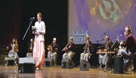 Lila Borsali performs on stage.