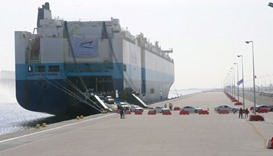 """A ship unloads vehicles at Hamad Port. Qatar's """"budget validates the government's keenness to contin"""