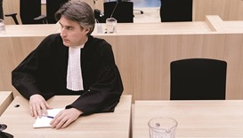Wilders' lawyer Maarten't Sas listens to the verdict against his client at the courtroom in Schiphol