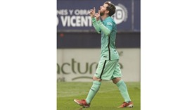 Messi double at Osasuna brings Barcelona relief