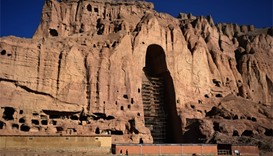 Afghan men at the site of the giant Buddha statues, which were destroyed by the Taliban