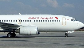 Chinese pilot suspended for urging passengers to protest delay