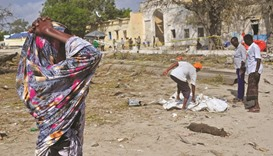A woman wails at the site of the attack near the port of Mogadishu.