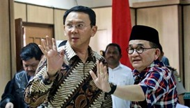 Jakarta governor denies insulting Qur'an in trial