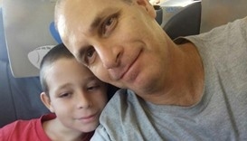 Father's bid to save son from cliff fall moves Israelis