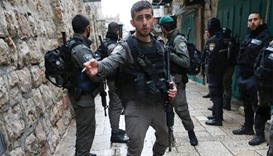 Israeli security forces patrol the streets near the site where a Palestinian was shot by Israeli pol