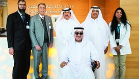 HMC officials with Qatari patient Jassim Mohamed Ali Abdulla - the first to be seen at QRI's outpati