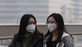Beijing issues red alert for severely high air pollution