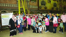 Participating children and families pose for photo during an event marking International Day of Pers