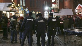 German police officers guard a Christmas market in the Prenzlauer Berg district in eastern Berlin, G