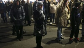 Berliners commemorate the 12 killed victims of a truck that ploughed into a Christmas market