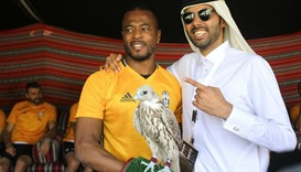 Juventus' Patrice Evra with a falcon