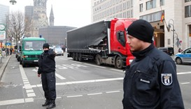 Policemen are seen in front of the truck which ploughed into a crowded Christmas market
