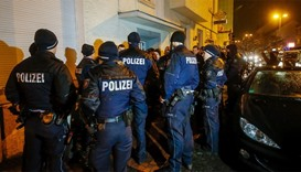 Policemen stand in front of a house in Dortmund, western Germany