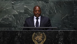 Kabila names transitional government, defying opposition
