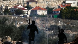 Israeli security forces take position near the settlement of Kadumim (background) during clashes